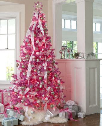 For a unique Christmas tree - try this DIY mod pink idea! This attention-grabbing hot pink tree feels like a winter wonderland when embellished with silver and white ornaments.Click to see more Christmas tree decorating ideas.