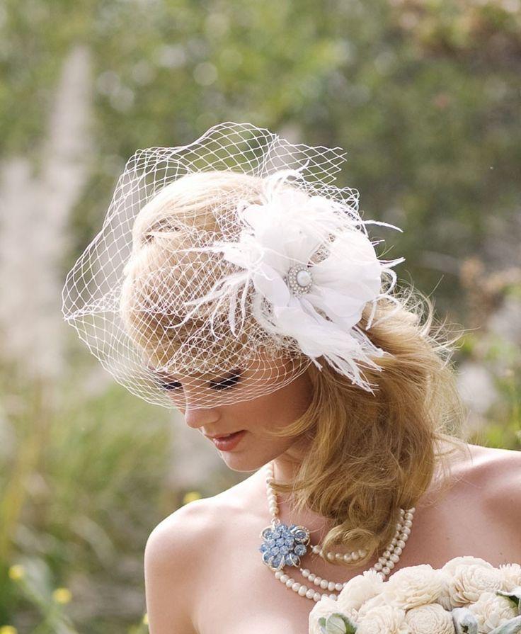 Feather Fascinator, True White, Birdcage Veil, Silk Hair Flower, Bridal Fascinator, Blusher Veil, Pearl, Crystal Center, Batcakes Couture. $149.00, via Etsy.