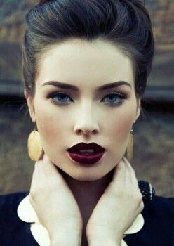 Dark hair, pale skin, and dark lips. Reminds me of myself! But I don't normally wear lipstick.