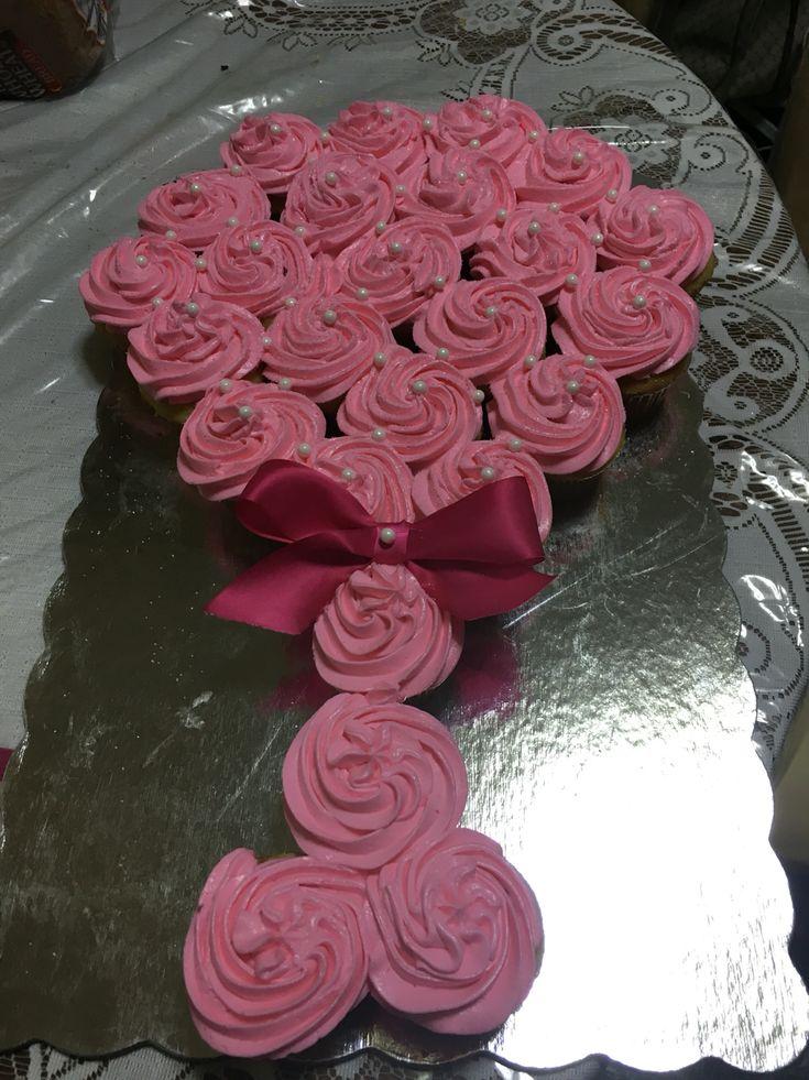 Baby shower.  Baby rattle cupcake cake