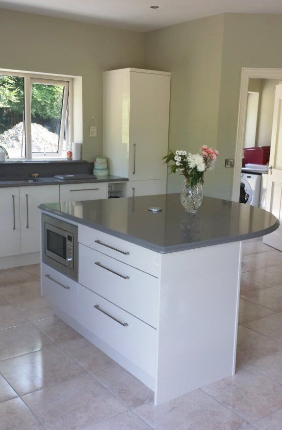 High gloss white lacquered door kitchen & island with warm ...