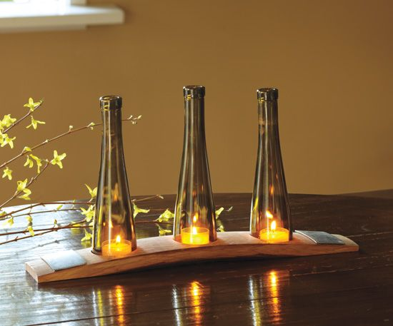 Tops of wine bottles used for Votives with a wine barrel stave as base.