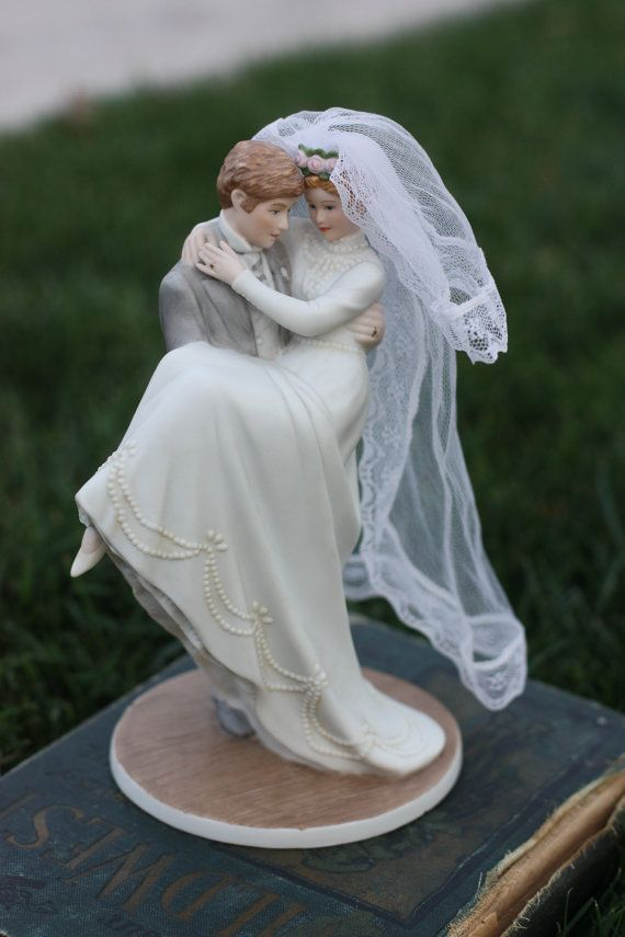 Vintage wedding cake topper 1990s by decymullens on Etsy, $64.99... traditional and could *kind of* look like you two...