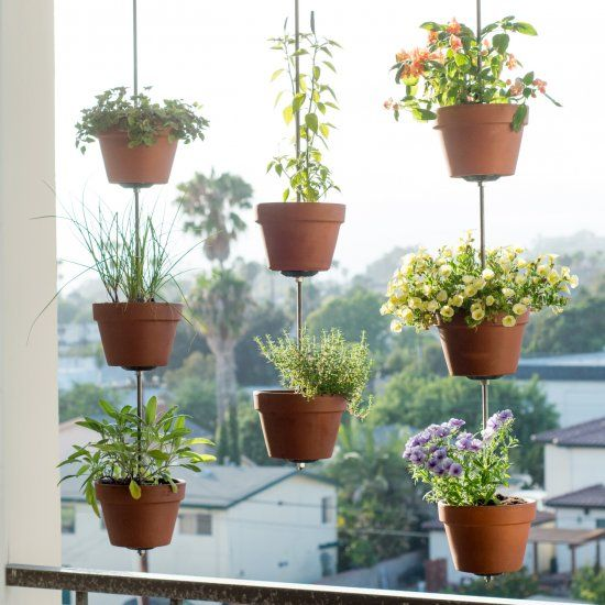 Maximize your balcony space by turning your clay pots into a hanging vertical garden.This DIY also makes a great privacy screen!