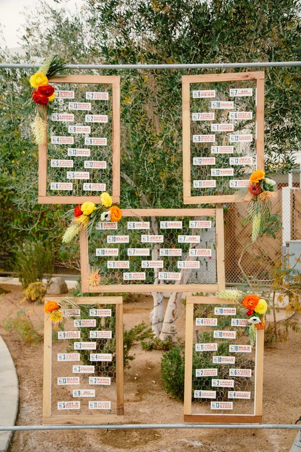 seating chart display, photo by Sweet Little Photographs http://ruffledblog.com/modern-palm-springs-wedding #seatingcharts #weddingideas #escortcards