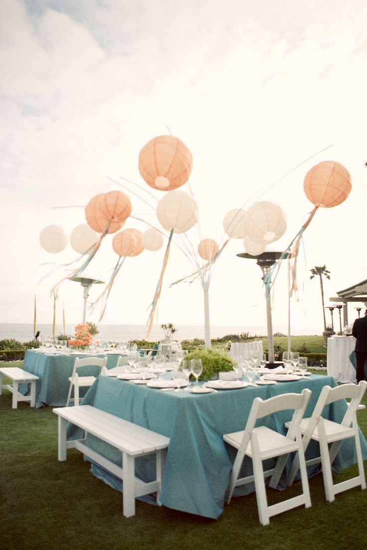 Paper lanterns with ribbon.  www.boutiqueTHEO.com  Photo by Aaron Delesie  Design by Lisa Vorce and Mindy Rice