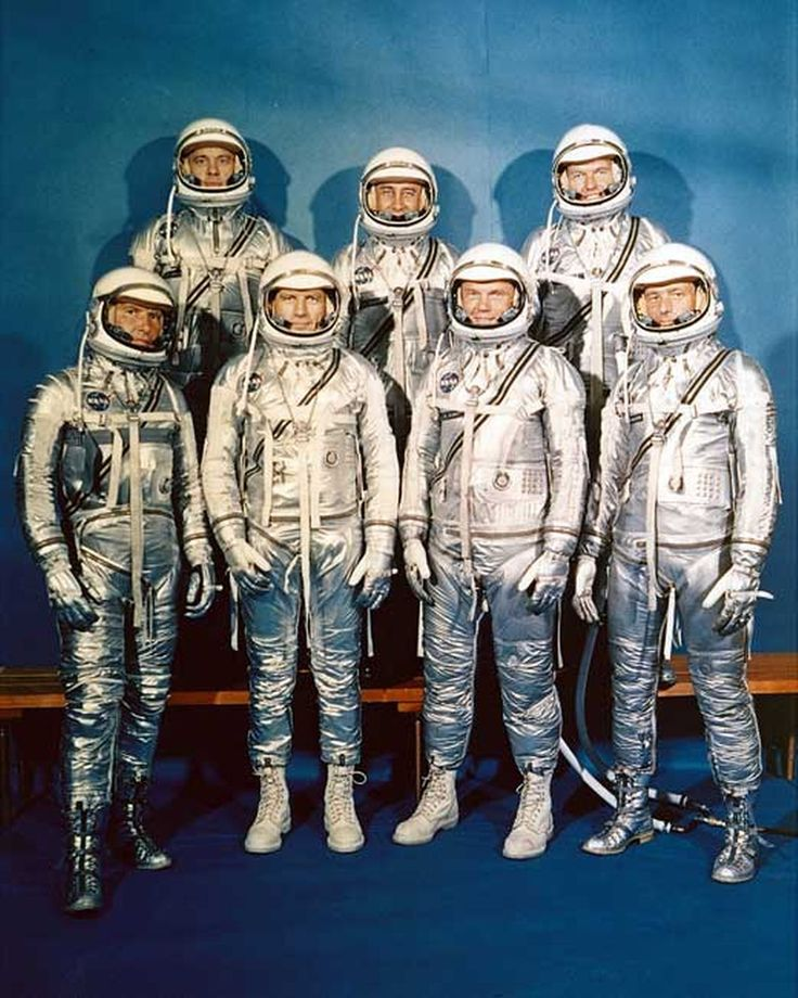 Project Mercury Astronauts, whose selection was announced on April 9, 1959. They are: front row, left to right, Walter H. Schirra, Jr., Donald K. Slayton, John H. Glenn, Jr., and Scott Carpenter; back row, Alan B. Shepard, Jr., Virgil I. Gus Grissom, and L. Gordon Cooper.