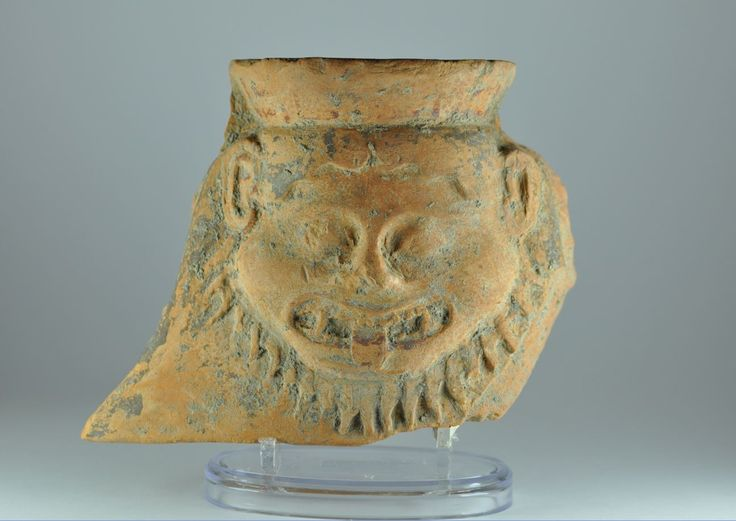 Gorgon antefix, Greek antefix with Gorgon head, archaic period, 5th century B.C. 15 xm high. Private collection