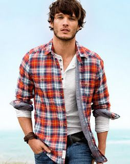Men's casual style. plaid shirt, henley, rolled sleeves, jeans, belt, wrap leather bracelet, scruff, shaggy hair.