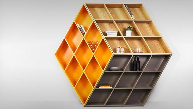Pour les fans du Rubik's Cube qui sont à la recherche de mobilier Geek, je viens de dénicher cette impressionnante étagère 3D imaginée par le designer George Bosnas. Comme on peut le voir en images, ce modèle unique de par sa forme et ses couleurs offre une illusion d'optique à couper le souffle. Idéal pour ranger ses livres et ses objets cultes. Pour en savoir plus sur le prix et la disponibilité de l'étagère RUBIKA, direction le site Anesis.