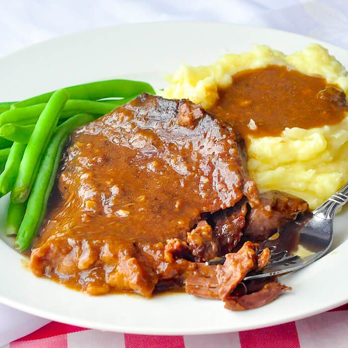 Stewed Steak turns inexpensive cuts of beef into fall-apart tender steaks & gravy in a tasty comfort food meal that can be adapted to the slow cooker too.