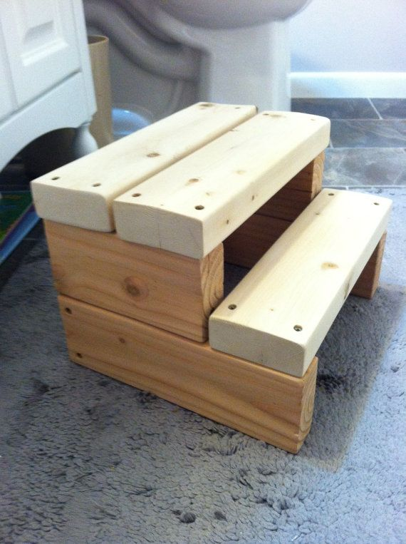A small wood step stool made from sturdy 2x4s. Great for helping little hands reach the sink or the potty, doggies get up onto your bed, or for grownups to reach the top shelf of the cupboard. The stool is unfinished so the wood is smooth and soft to the touch. You can paint it yourself to add a personalized touch or leave it as is.  Each stool is made to order, which takes 1-2 weeks. Stools are sent by USPS Standard shipping which takes from 5-9 business days to reach the destination…