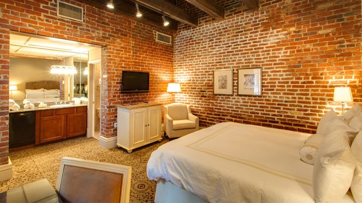 """This French Quarter boutique hotel offers an elegant, historic feel: Among the Dauphine's properties is the Audubon Room, where the famous naturalist painted his """"Birds of America"""" series. Another big draw is the hotel's suites: Brick walls and wooden posts are the backdrop to modern comforts like an en-suite kitchen. Ask the staff about paranormal sightings, too, because where there's history, a ghost can't be far behind."""
