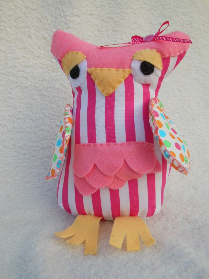 Sleepy doorstop owl in bright pink stripes and coloured polka dots.