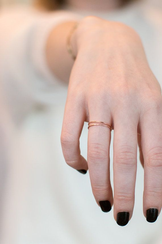 This hammered 14k rose gold ring is a very delicate band, it is *whisper thin* and very feminine. This plain handmade gold ring is a lovely addition to your stacking rings set. At only 1mm thin, this is the most delicate ring in the shop. This is a special little ring: we recommend wearing this piece alone as a soft minimal accent piece, or wear stacked in a set of many rings on the same finger. This ring will be finished with your choice of a bright or brushed matte polish.  ♡ A perfect…