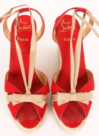Red strap heels with pink bows.
