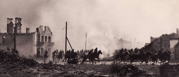 Polish cavalry galloping through a bombed town during the German invasion of Poland in 1939.