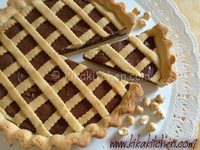 Crostata+alla+nutella++++Ingredienti+crostata+alla+nutella+++++500+g+di+farina+00+++200+g+di+zucchero+++200+g+di+burro+freddo+++2+uova+medie+++1+cucchiaino+di+estratto+di+vaniglia+oppure+una+bustina+di+vanillina+++la