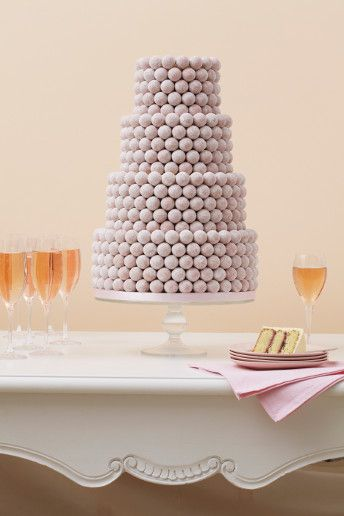Inspired by Marie Antoinette and based on a traditional French wedding cake, each of the tiers is layered with antique pink marzipan and decorated with row after row of Pink Marc de Champagne truffles