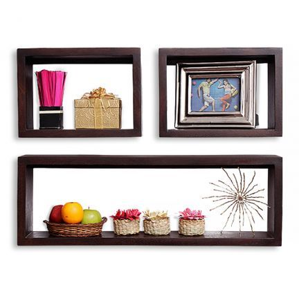 Fab Home Mojito Wall Shelf - A modern wall shelf to revive your living room walls, this one is stylish and compact. Accessorize your home or workspace with its simple look. A rich walnut finish on a tropical fruit wood construction lends it class and durability. Place lights around these three shelves to add a playful element to the walls. Salient Features:* An exquisite item that has been handcrafted and boasts of refined craftsmanship* Crafted from superior quality solid wood* A home…