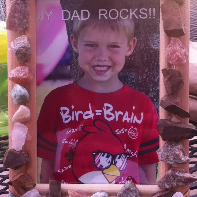 """Father's Day craft.  Plain pic frame from local craft store, rocks purchased from craft store hot glue rocks around border and take pic of your child and add text """"my dad rocks!"""" I did this project with my daycare kids"""