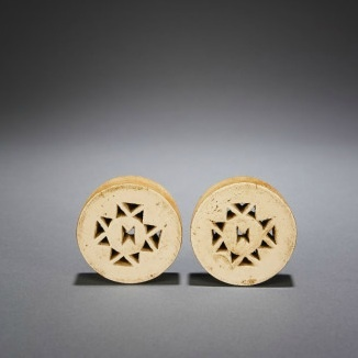Africa | Zulu Wood Ear Plugs - South Africa | ca 1920s - 1940s | At an early age, a Zulu child's earlobes were pierced and gradually stretched to allow for larger and larger ear plugs to be worn.