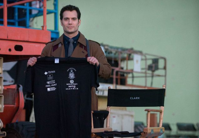 The Royal Marine Charitable Trust Fund, a UK organization that Henry Cavill serves as an ambassador for, revealed a photo of Cavill, on set, in costume as Clark Kent: