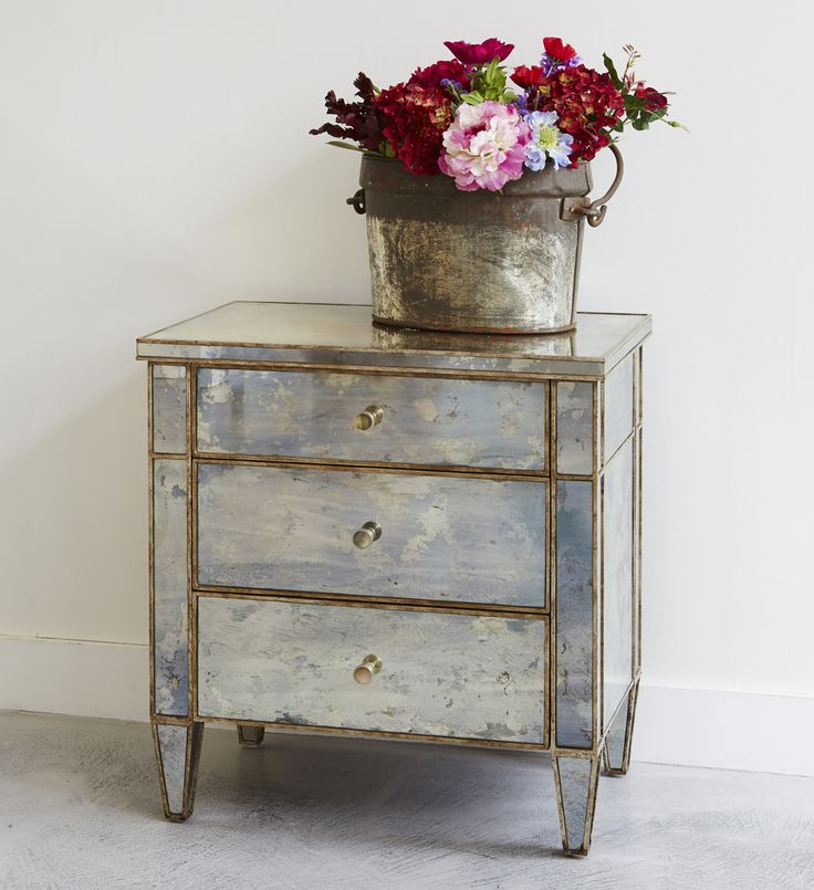 Our Valentino bedside chest features panels of antiqued glass and a frame artfully painted to resemble rusted metal simonhorn.com