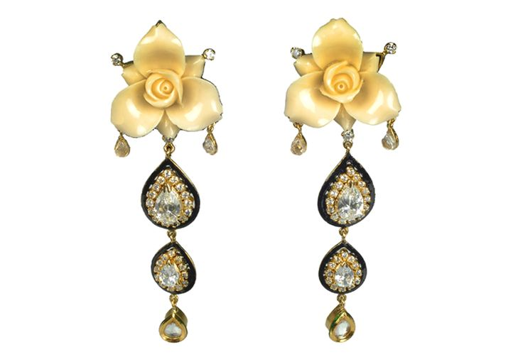 Increase your glam quotient with rose design earrings by Amalaan Jewels. Shop it from TheAmalaanStore.com