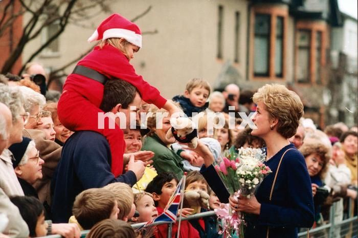 December 9 1992 Princess Diana, HRH The Princess of Wales, greets well-wishers during her visit to Tyne and Wear, Whitley Bay and The North East of England During her trip she visited the charity Turning Point and Interconnection Systems. A young girl dressed as Father Christmas, aloft on her fathers shoulders, offers the Princess a teddy bear.  On this day also, 9th December 1992, Princess Diana and Princes Charles have announced their separation.