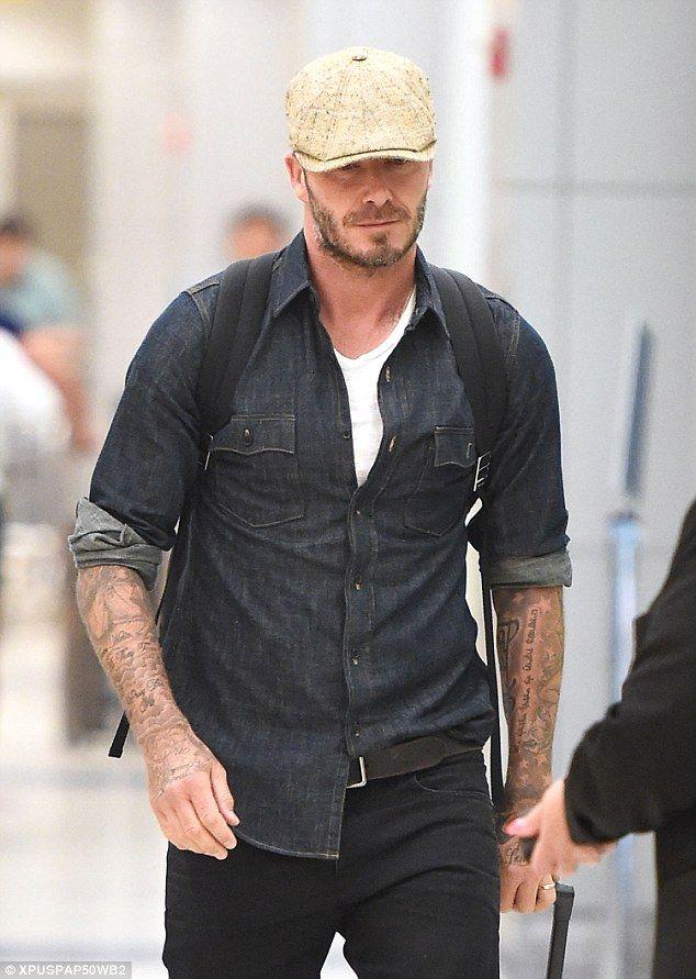David Beckham drives his mud soaked Land Rover through London ... 47e88a698b4