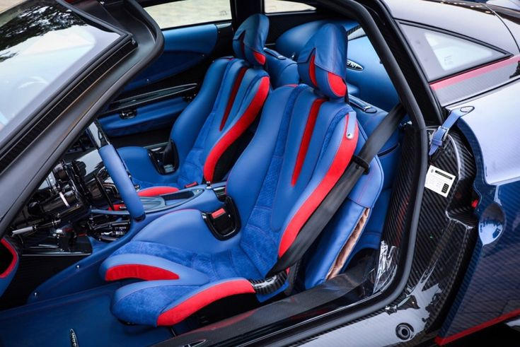 Interior of the Pagani Huayra BC made out of exposed Blue & Black carbon fiber w/ Red & Blue accents  Photo taken by: @pagani_japan on Instagram