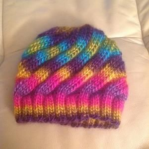 "Swirl hat for charity.  Lion Brand Landscapes yarn - I didn't like working with this at all and it was beginning to ""halo"" while I was working on it.  Completed 9/30/15."