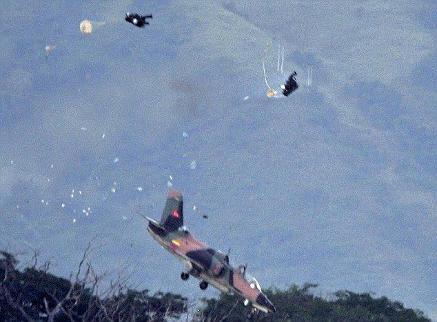 Split-second moment two pilots eject from doomed fighter jet before it crashes and erupts into a fireball at airshow