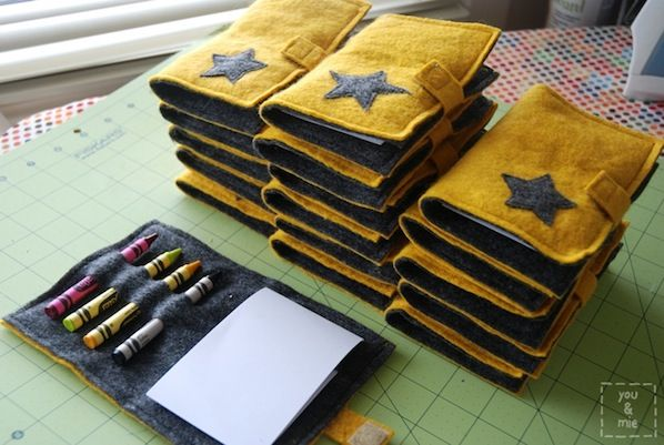 Felt Crayon Notebook.--I didn't sew them(I used tacky glue because I had a small helper) & I used ribbon to close. Also instead of blank paper I found coloring book pages to use. Overall super easy craft!!! A bit labor intensive(no quick way to cut slits for crayons & books) but very easy!!