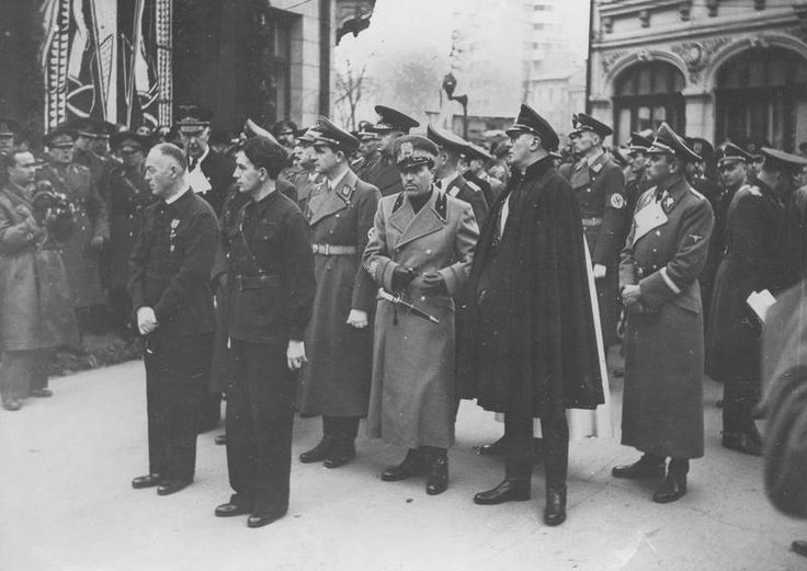 Prime Minister of Romania Ion Antonescu (first row, first from left) and chief of Legionnaires Horia Sima (next to the Prime Minister) in mourning for Iron Guard charismatic founder and leaders Corneliu Codreanu and his companions. On the second row Gauleiter Ernst Wilhelm Bohle (third from right) and the German Ambassador in Romania Wilhelm Fabricius (first from left, second row), November 1940.