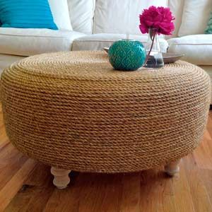 Rope ottoman made out of old tire. Could even use this idea for my cats a scratching post.