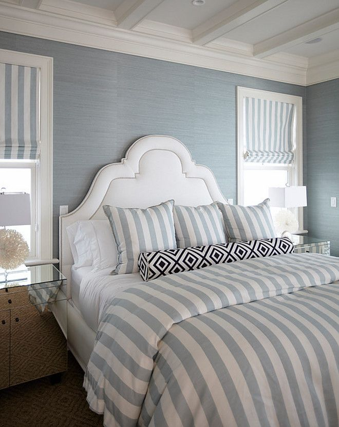Master bedroom. What a dreamy master bedroom! The custom upholstery features fabrics from China Seas, Thibaut and Sunbrella.