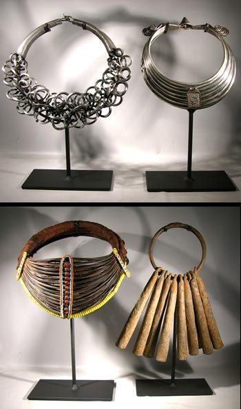 Chinese Miao silver necklaces along with a Samburu collar and iron bells from Africa.