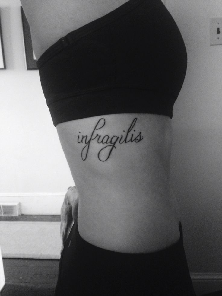Infragilis rib tattoo. Latin for unbreakable and strong.