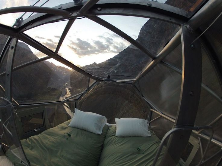 Suspended 400 feet above Peru's Sacred Valley of Cusco are three capsules that appear like Space Age airstream trailers. These transparent sleeping pods are intended for unfazed adventures, crafted from aerospace aluminum and weather resistant polycarbonate giving each visitor a 300 degree view of t