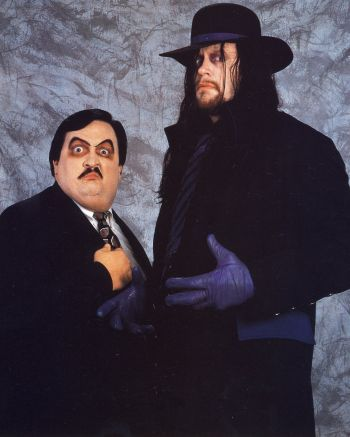 """William Moody, aka """"Paul Bearer,"""" was not only a """"maanger"""" of several wrestlers in WWE (The Undertaker, his first, is on the right) died at the age of 58 on March 5, 2013. Moody was also a licensed mortician."""