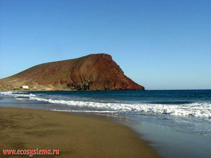 The ancient volcano Montana Roja (171 meters height) and sandy beach Playa de la Tejita. South of the Tenerife Island, Canary Archipelago