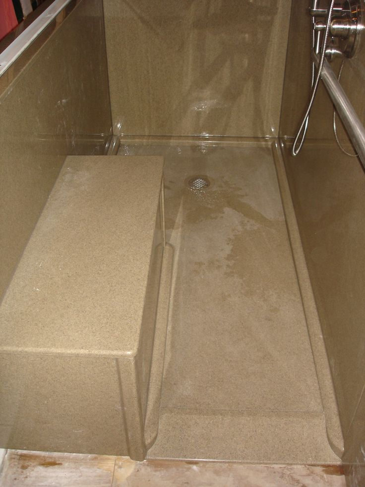 custom ada ramped shower base with bench seat