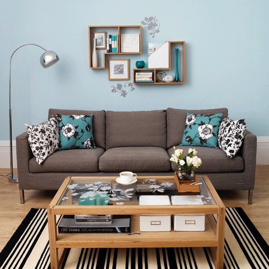 This gray/brown couch would look good- walls are a similar color blue
