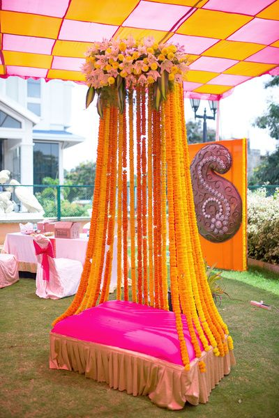 bridal seat, bridal jhoola, outdoor, small stage, bride, groom , sofa, bright pink, genda flowers, tall, unique
