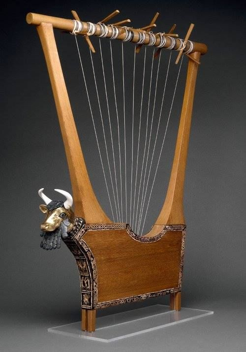 Proto-Sumerian Dynastic Period (2900-2350 BC) This lyre was found in the tomb of King Pu-abi (2600 BC). Along with the lyre, were found the bodies of ten women, wearing fine jewelry. A woman was lying near the lyre with the bones of her hands next to where they should be strings. The front panels are made of lapis lazuli, & red limestone shells. The golden mask of the bull has been restored, beard, hair, and eyes are original & made of lapis lazuli, the horns are rebuilt.