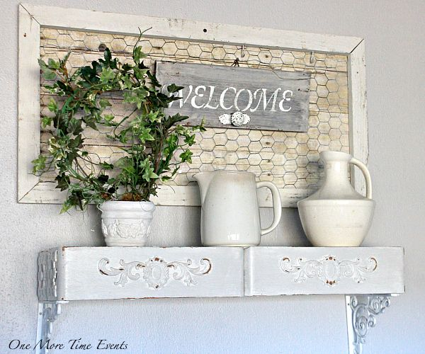 Welcome wall decor ivy planted wreath welcome sign with decorative knob rustic framed faux wood chicken wire iron stone pitchers vintage sewing drawers shelf