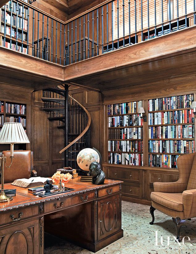 An antique desk occupies the lower level of this Long Island home's library.