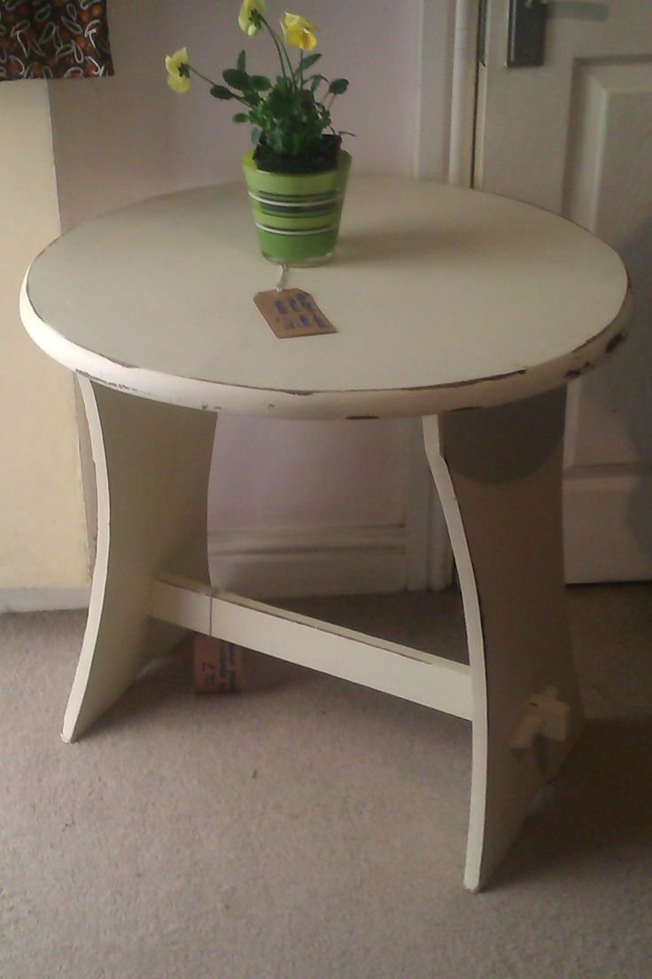 Painted cream and waxed heavy round wooden table. Measures H.65cms W.65cms £70